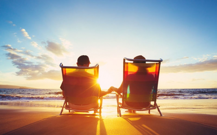48837144 - retirement vacation concept, happy mature retired couple enjoying beautiful sunset at the beach