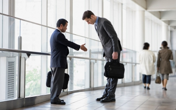 Businessmen shaking hands and bowing
