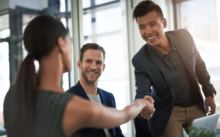 Job hunter shaking hands with recruiter