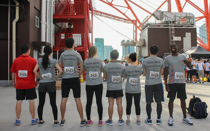 The runners show their tshirts and race numbers