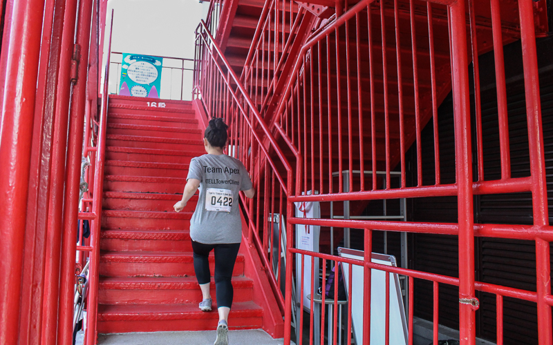 The race begins and the runners race up the stairs